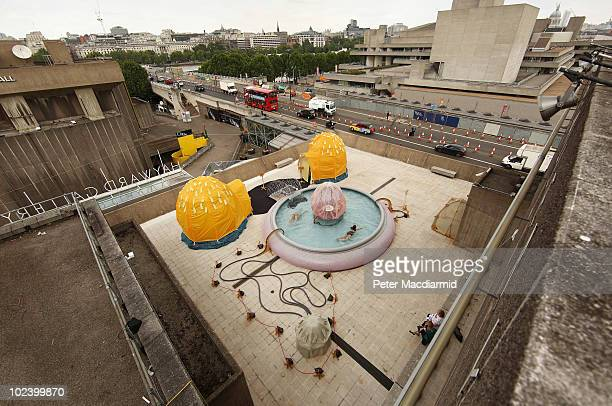 Swimmers take a plunge in a pool on the roof of The Hayward Gallery on June 25 2010 in London England The pool is part of Brazilian artist Ernesto...