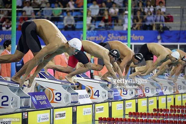 Swimmers take off the starting block during the men's 4x100m freestyle relay final on day five of 2014 Asian Games at Munhak Park Taehwan Aquatics...