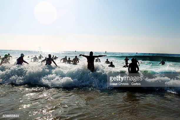 Swimmers take part in a circuit course from Manly Beach out by Fairy Bower point and over the reef around the point along Shelley Beach around the...