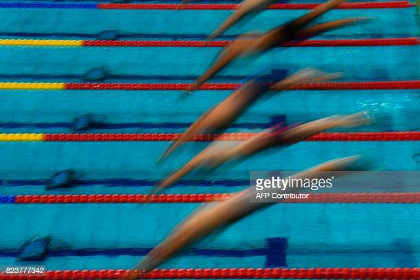 Swimmers take the start in a heat of the men's 50m freestyle during the swimming competition at the 2017 FINA World Championships in Budapest on July...