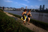Swimmers walk along the Yangtze River on August 4 2013 in Chongqing China Chongqing is a major city in southwest China and became the municipality...