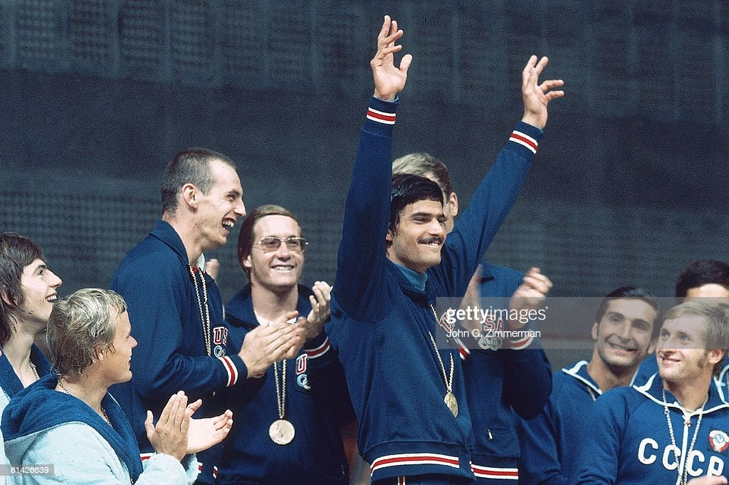 1972 Summer Olympics, USA Mark Spitz victorious with gold medal on stand, Munich, West Germany 8/26/1972--9/11/1972