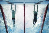 2008 Summer Olympics Underwater view of USA Michael Phelps and Serbia Milorad Cavic in action touching wall to finish Men's 100M Butterfly Final at...