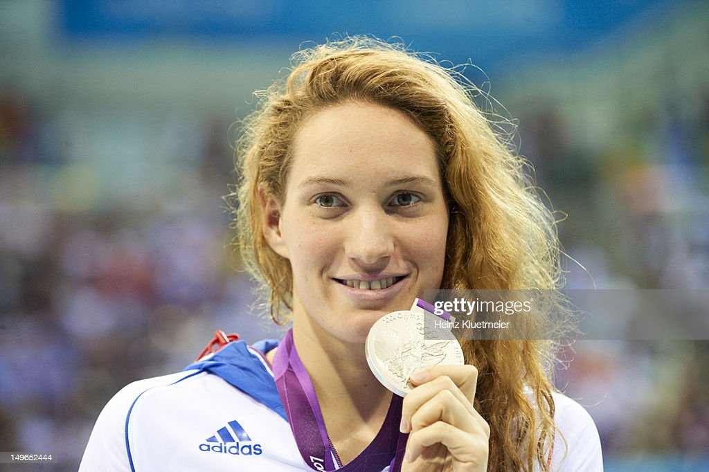 Closeup of France <a gi-track='captionPersonalityLinkClicked' href=/galleries/search?phrase=Camille+Muffat&family=editorial&specificpeople=596271 ng-click='$event.stopPropagation()'>Camille Muffat</a> with silver medal after Women's 200M Freestyle Final at Aquatics Centre. Heinz Kluetmeier F20 )