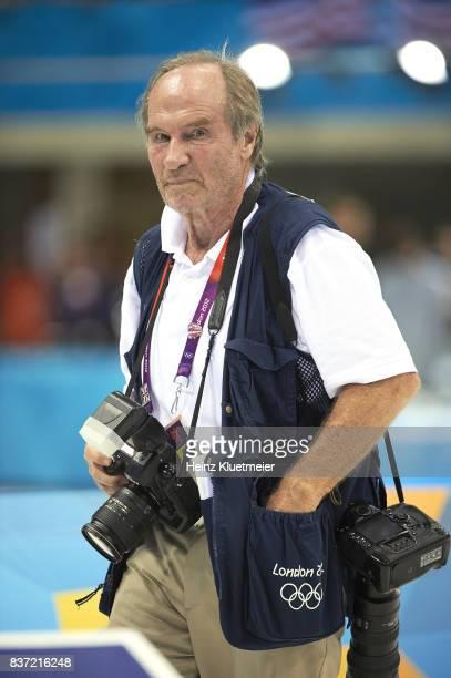 2012 Summer Olympics Closeup portrait of Sports Illustrated photographer Heinz Kluetmeier during Men's 4x100M Medley Relay Final at Aquatics Centre...