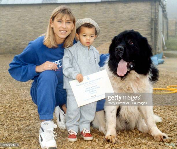 Swimming and TV star Sharron Davies with son Elliott present a Royal Lifesaving Certificate to Newfoundland dog Harry in the Cotswolds Harry who...