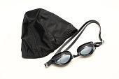 Black swimming cap and goggles.