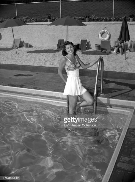 Swimming champion and future movie star Esther Williams poses for a portrait in the pool at The Beverly Hills Hotel in 1939 in Beverly Hills...