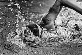 Swimming fast - high speed action shot in black and white