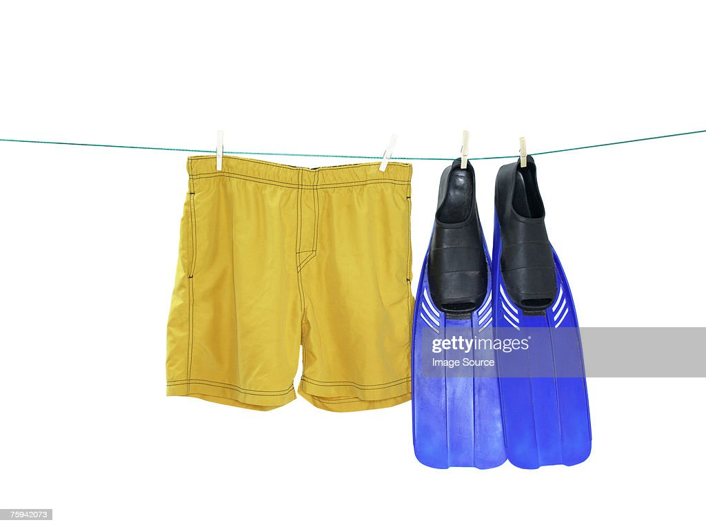 Swimming flipper and trunks on a washing line