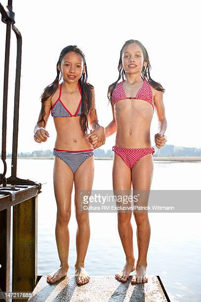 Swimming girls on wooden dock