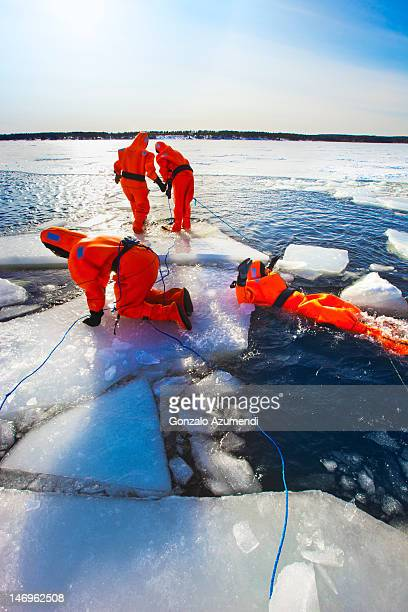 Swimming in the frozen sea with neoprene suits.