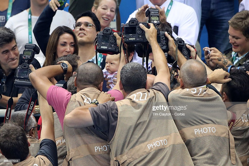 Day 4 Michael Phelps's son Boomer is photographed as Michael Phelps visits his son and finance Nicole Johnson in the stands after the gold medal presentation for winning the Men's 200m Butterfly Final during the swimming competition at the Olympic Aquatics Stadium August 9, 2016 in Rio de Janeiro, Brazil.