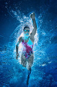 Front crawl swimmer. Underwater view, toned image