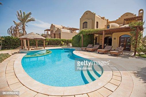 Swimming pool at at luxury tropical holiday villa resort : Stock Photo