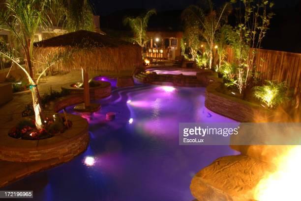 Swimming pool at night lite up purple