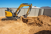 Excavation works for the installation of a swimming pool.Swimming pool under construction.