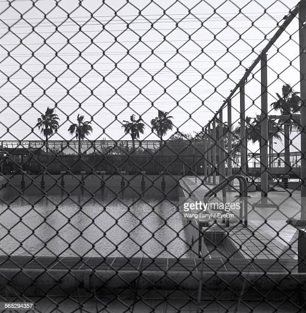 Swimming Pool Seen Through Chainlink Fence