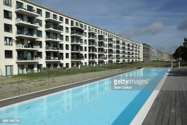 A swimming pool stands next to completed holiday apartments in Block 2 of the Prora building complex on Ruegen Island on June 15 2017 in Binz Germany...