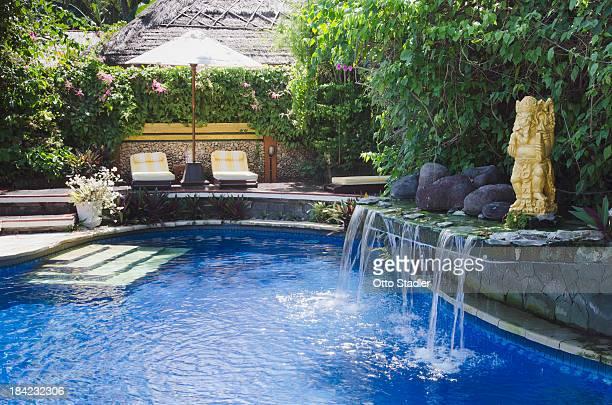 Swimming pool with little waterfall