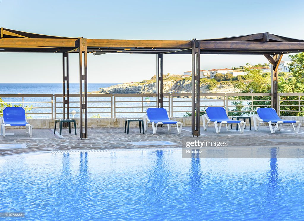 Swimming pool with sun loungers stock photo getty images for Swimming pool loungers