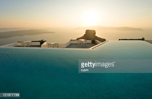 Swimming pool with sunset, Santorini, Greece
