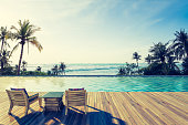 Beautiful view of Swimming Pool with  the sea at sunlight ,Vintage Tone - 3d rendering