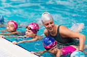 Swimming school - Swimming instructor with children