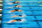Swimming, women at start of backstroke race (blurred motion)