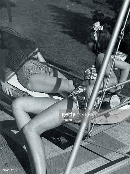 Swimmsuits Berlin Germany Photography 1940 [Deutsche Bademode Zwei Badeanzuege der eine in Fischgraetmuster der andere zweiteilig mit blauem...
