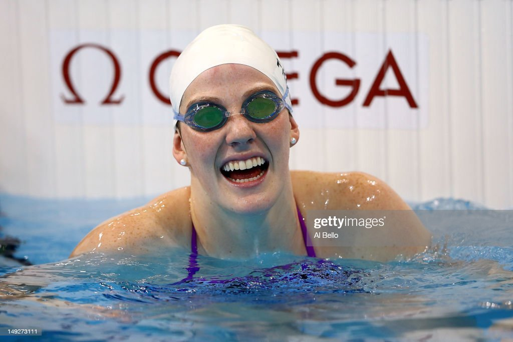 Swims <a gi-track='captionPersonalityLinkClicked' href=/galleries/search?phrase=Missy+Franklin&family=editorial&specificpeople=6623958 ng-click='$event.stopPropagation()'>Missy Franklin</a> of the United States of America smiles in the pool during a training session ahead of the London Olympic Games at the Aquatics Centre in Olympic Park on July 26, 2012 in London, England.