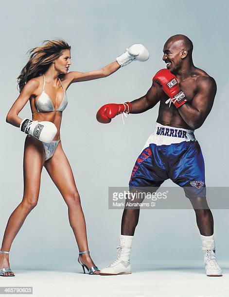 Swimsuit Issue 2000 Model Heid Klum and boxer Evander Holyfield are photographed for the 2000 Sports Illustrated Swimsuit issue on June 23 1999 in...