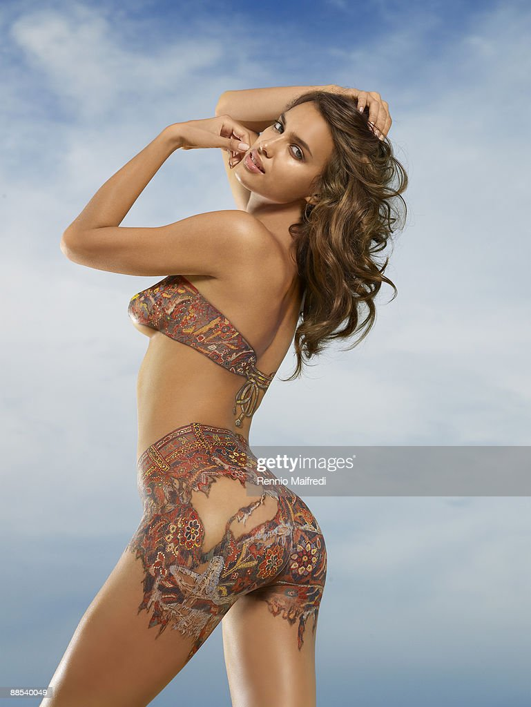 model irina shayk is photographed for swimsuit issue 2009 body