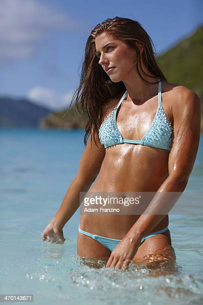 Swimsuit Issue 2014 Soccer player Alex Morgan poses for the 2014 Sports Illustrated Swimsuit issue on November 19 2013 on Guana Island PUBLISHED...