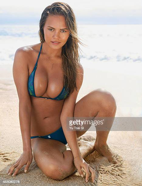 Swimsuit Issue 2015 Model Chrissy Teigen poses for the 2015 Sports Illustrated Swimsuit issue on July 20 2014 in the United States Swimsuit by TeenyB...