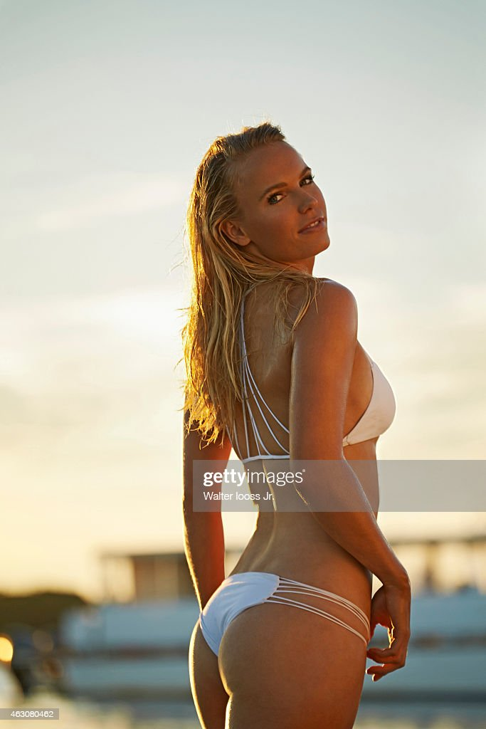 Tennis player Caroline Wozniacki poses for the 2015 Sports Illustrated Swimsuit issue on November 13, 2014 on Captiva Island, Florida. Swimsuit by MIKOH. PUBLISHED IMAGE.