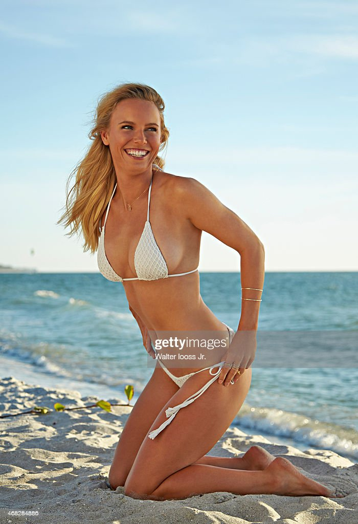 Tennis player Caroline Wozniacki poses for the 2015 Sports Illustrated Swimsuit issue on November 12, 2014 on Captiva Island, Florida. Swimsuit by Acacia Swimwear.