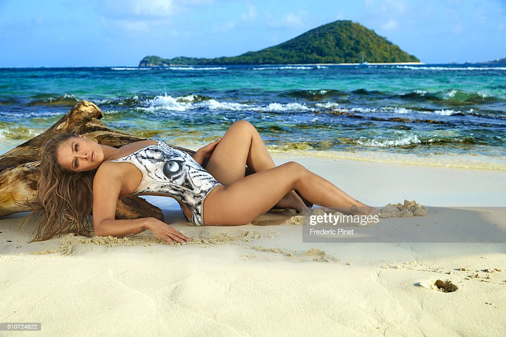 Mixed martial artist and actress Ronda Rousey poses for the 2016 Sports Illustrated swimsuit issue on January 5, 2016 in Saint Vincent and The Grenadines. Body painting by Joanne Gair. PUBLISHED IMAGE.