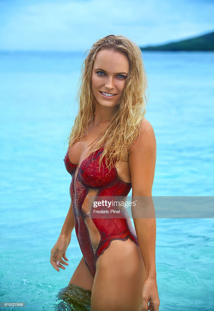 Tennis player Caroline Wozniacki poses for the 2016 Sports Illustrated swimsuit issue on November 19, 2015 in Saint Vincent and The Grenadines. Body painting by Joanne Gair. PUBLISHED IMAGE. NO SALES IN NORTH AMERICA UNTIL MAY 15, 2016.
