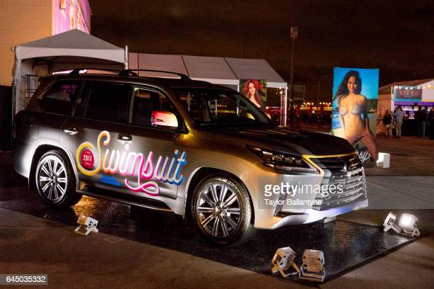SI Launch Week View of Lexus SUV car with SI Swimsuit logo parked outside during SI Swimsuit Vibes event at The Post HTX View of photo blowup of...