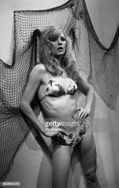 Swimwear from Woolworth's is worn by top model Vicki Hodge She is modelling a floral nylon bikini with a halter neck made in navy and purple or brown...