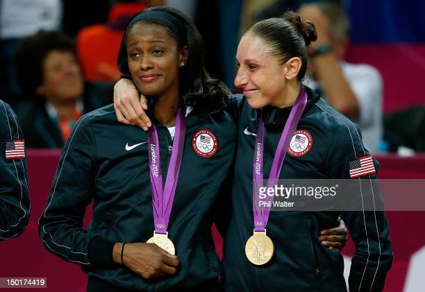 Swin Cash and Diana Taurasi of United States celebrate after defeating France 8650 to win the gold medal in the Women's Basketball gold medal game on...