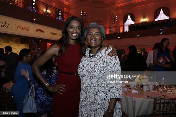 Swin Cash and Donna Brazile the recipient of the 2014 WNBA Inspiration Award pose for a photo during the Inspiring Women Luncheon on September 5 2014...