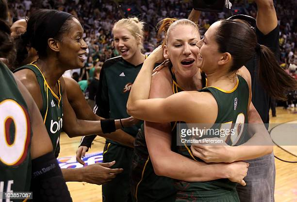 Swin Cash Lauren Jackson and Sue Bird of the Seattle Storm celebrate after defeating the Phoenix Mercury in Game Two of the Western Conference Finals...
