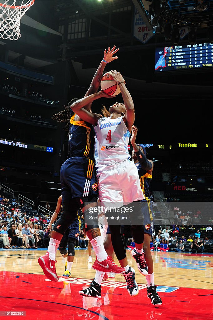 <a gi-track='captionPersonalityLinkClicked' href=/galleries/search?phrase=Swin+Cash&family=editorial&specificpeople=202486 ng-click='$event.stopPropagation()'>Swin Cash</a> #4 of the Atlanta Dream goes up for a shot against the Indiana Fever on July 1, 2014 at Philips Arena in Atlanta, Georgia.
