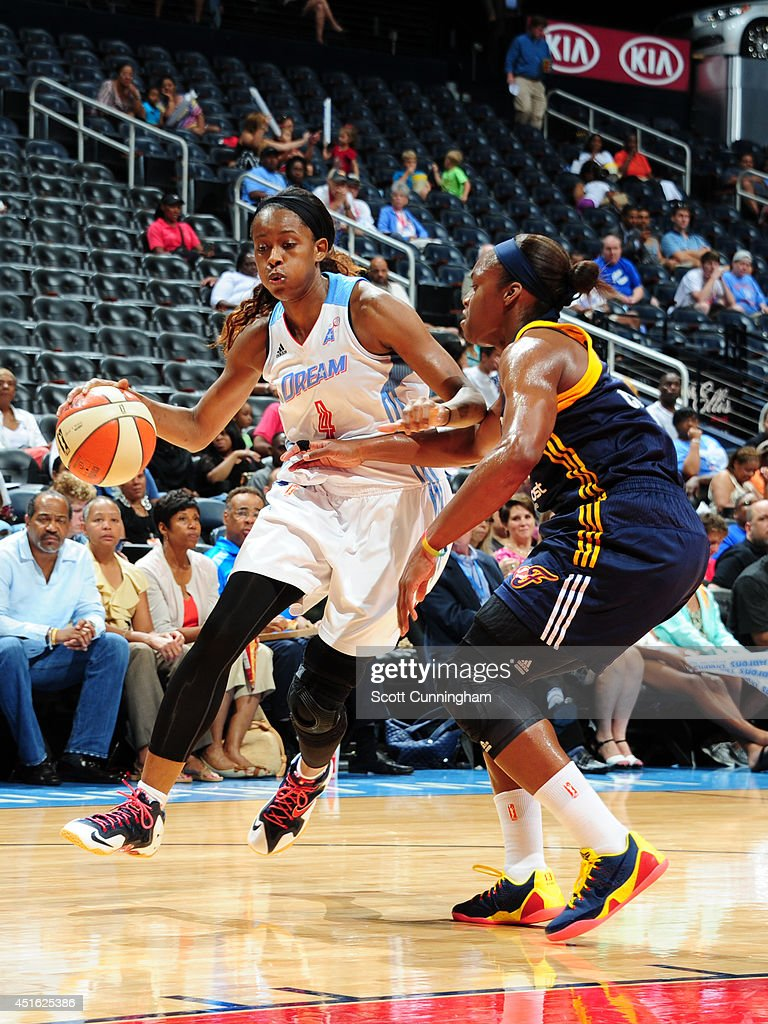 <a gi-track='captionPersonalityLinkClicked' href=/galleries/search?phrase=Swin+Cash&family=editorial&specificpeople=202486 ng-click='$event.stopPropagation()'>Swin Cash</a> #4 of the Atlanta Dream handles the ball against the Indiana Fever on July 1, 2014 at Philips Arena in Atlanta, Georgia.