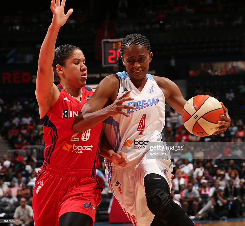 Swin Cash #4 of the Atlanta Dream handles the ball against the Washington Mystics at Philips Arena on July 5, 2014 in Atlanta, Georgia.