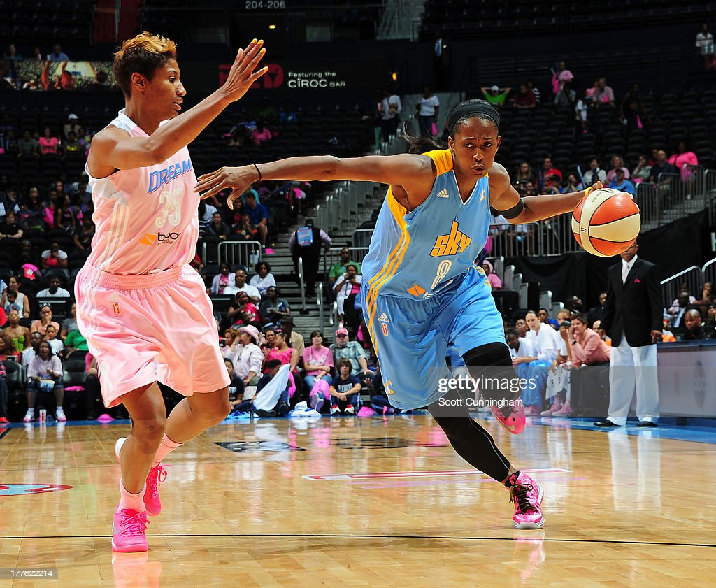 Swin Cash #8 of the Chicago Sky drives against Angel McCoughtry #35 of the Atlanta Dream at Philips Arena on August 24 2013 in Atlanta, Georgia.