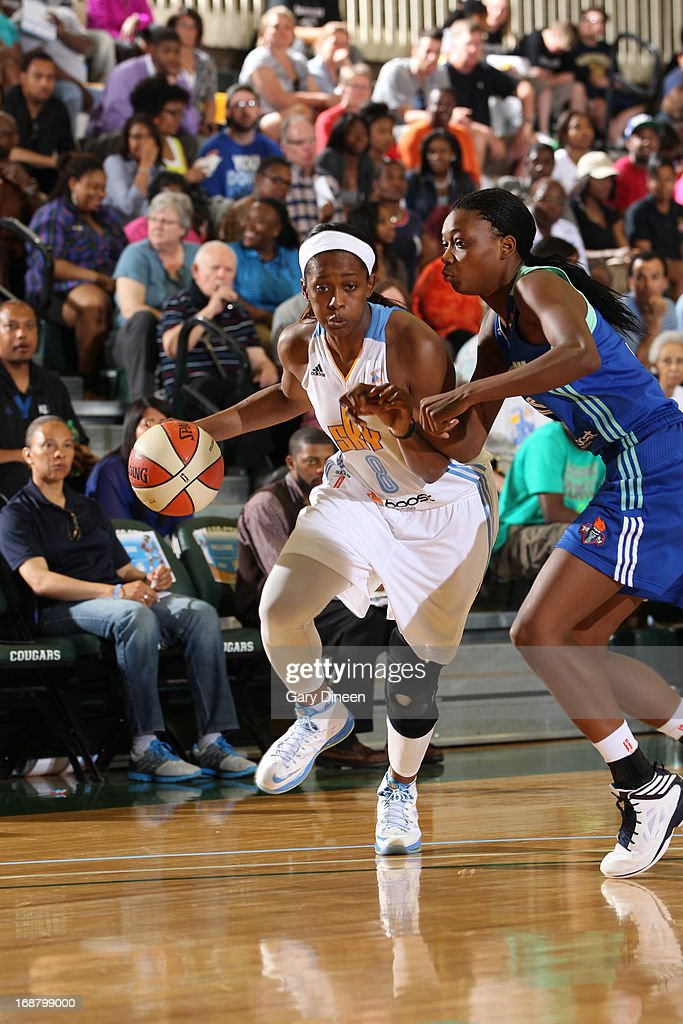 Swin Cash #8 of the Chicago Sky drives past Toni Young #15 of the New York Liberty during the pre-season game on May 15, 2013 at the Jacoby D. Dickens Physical Education and Athletic Center on the campus of Chicago State University in Chicago, Illinois.