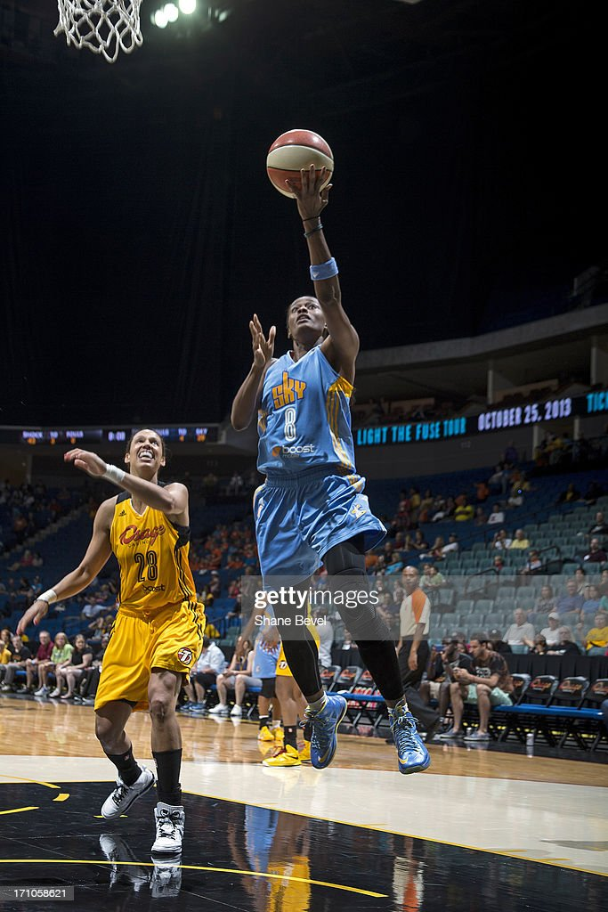 <a gi-track='captionPersonalityLinkClicked' href=/galleries/search?phrase=Swin+Cash&family=editorial&specificpeople=202486 ng-click='$event.stopPropagation()'>Swin Cash</a> #8 of the Chicago Sky drives to the basket against the Tulsa Shock during the WNBA game on June 20, 2013 at the BOK Center in Tulsa, Oklahoma.
